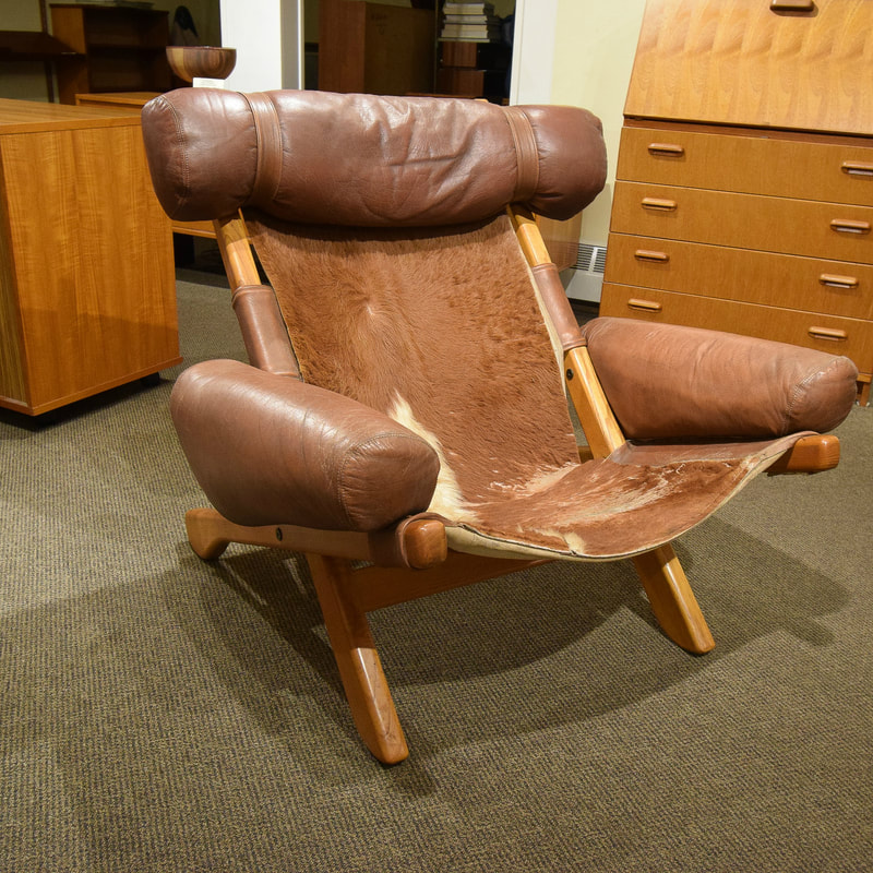 COOL MID-CENTURY MODERN LEATHER AND OAK EASY CHAIR...$2500.00