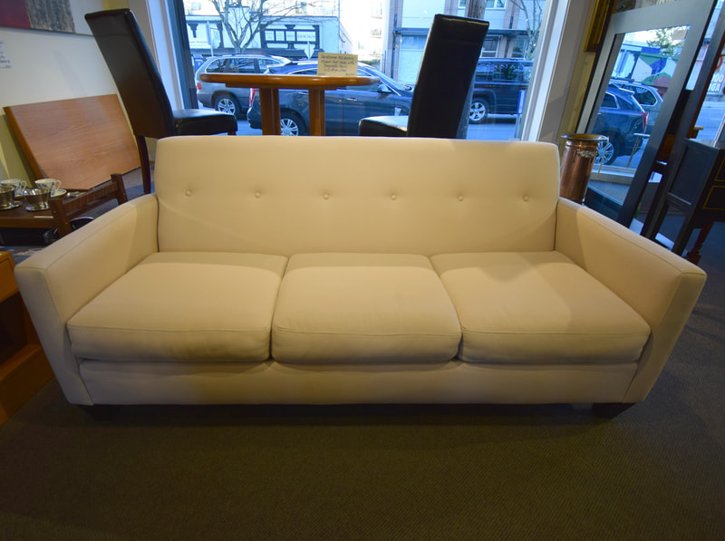 LOVELY MODERN CREAM BUTTON BACK SOFA...$749.00